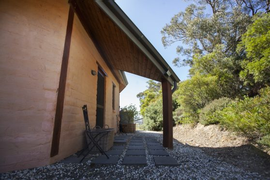 A mixture of wood and mud brick gently constructed into the ridge