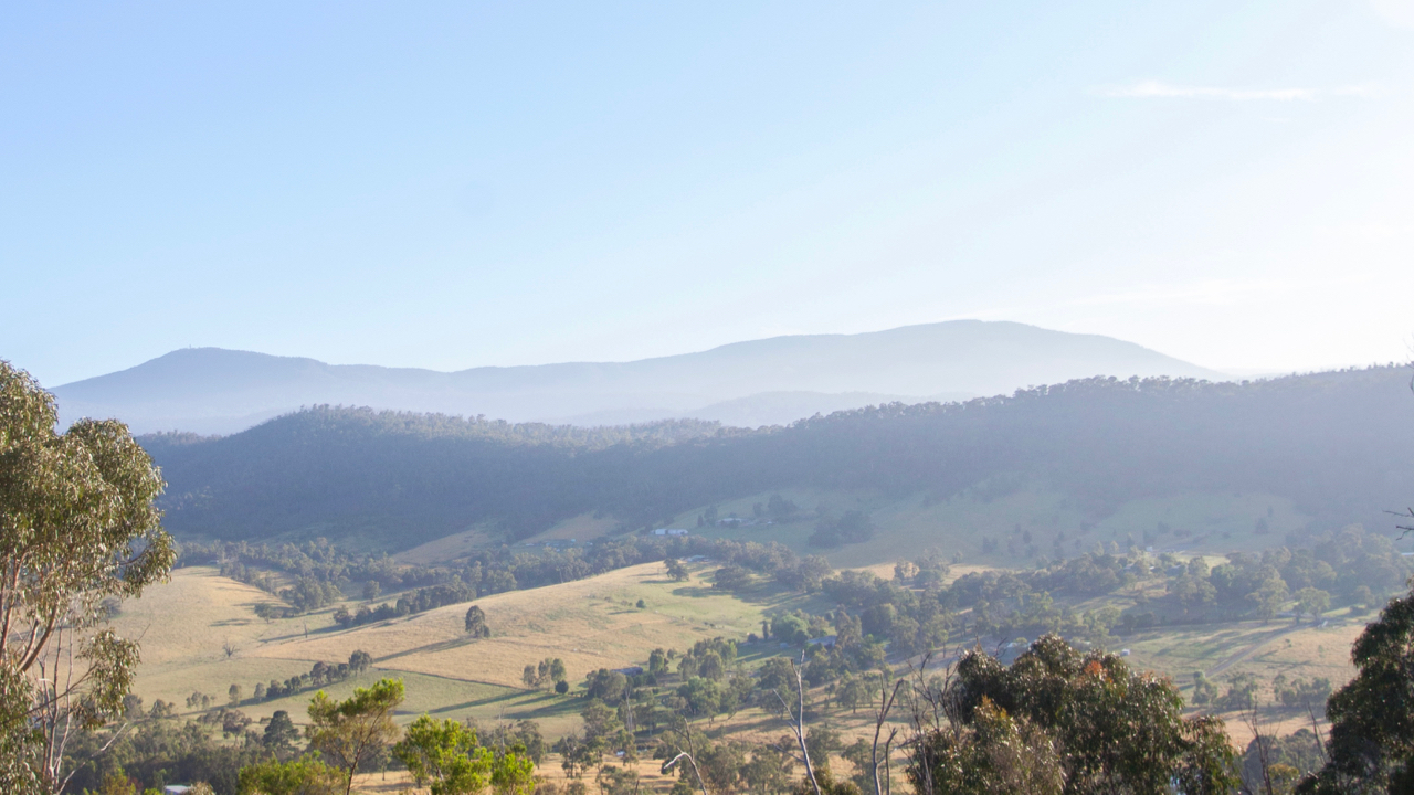 The cabins overlook the Healesville mountains.