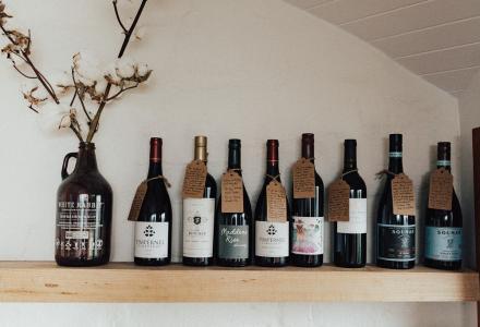 Bottles of wine on a shelf from Kangaroo Ridge Retreat Larder
