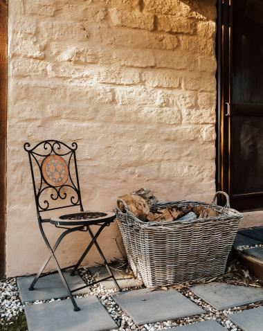 outdoor chair and firewood